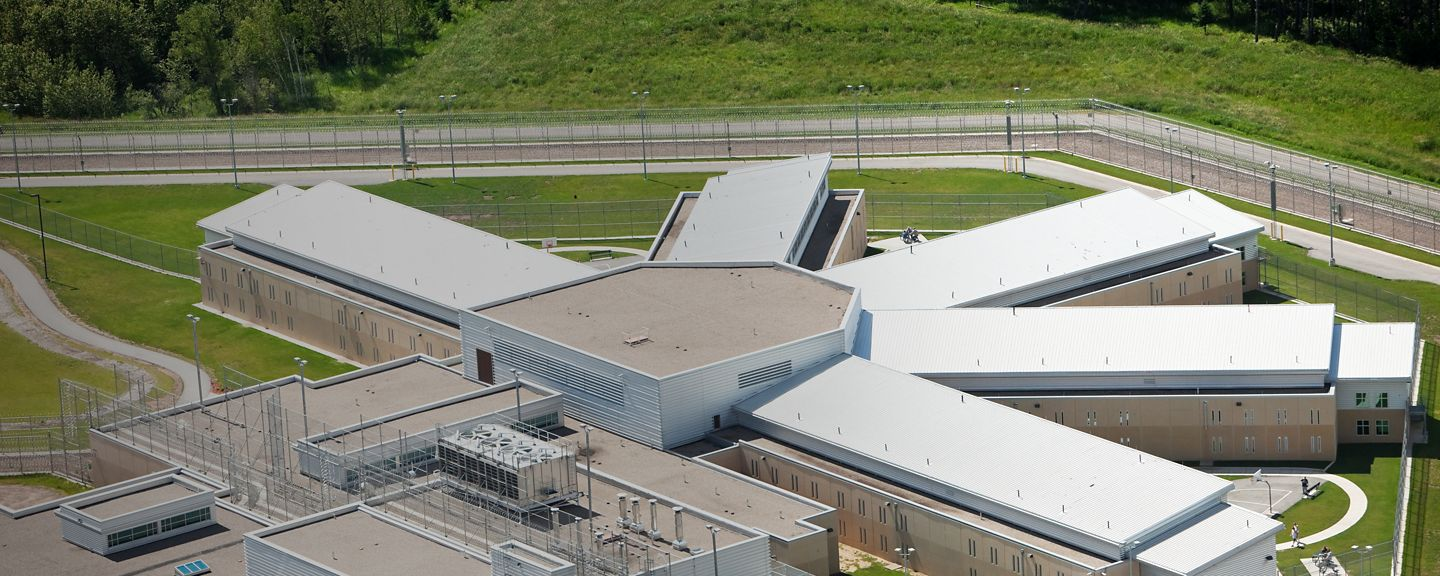 A modern podular prison cell block aerial view. The pod with wings decentralizes prisoners into smaller groups for easier control. Outdoor areas are separated to prevent large gatherings of prisoners.http://www.banksphotos.com/LightboxBanners/Aerial.jpg