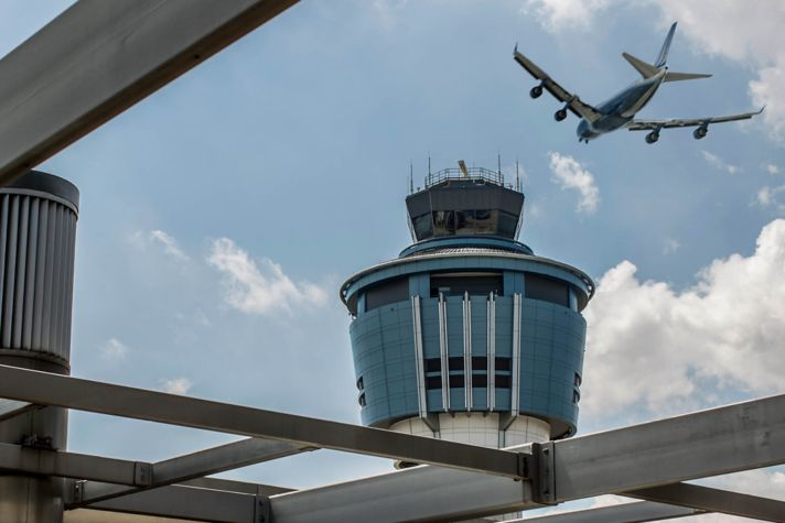 Plane Over Aerport Tower