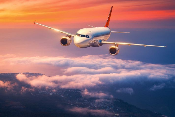 Airliner in flight sunset