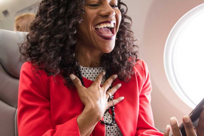 Woman Laughing at Phone