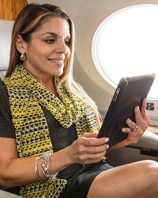 Lady with tablet in business jet