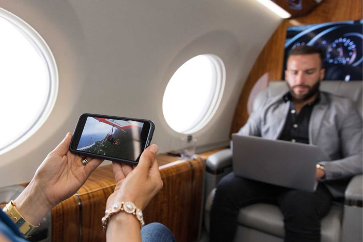 Passenger using iPhone in Cabin
