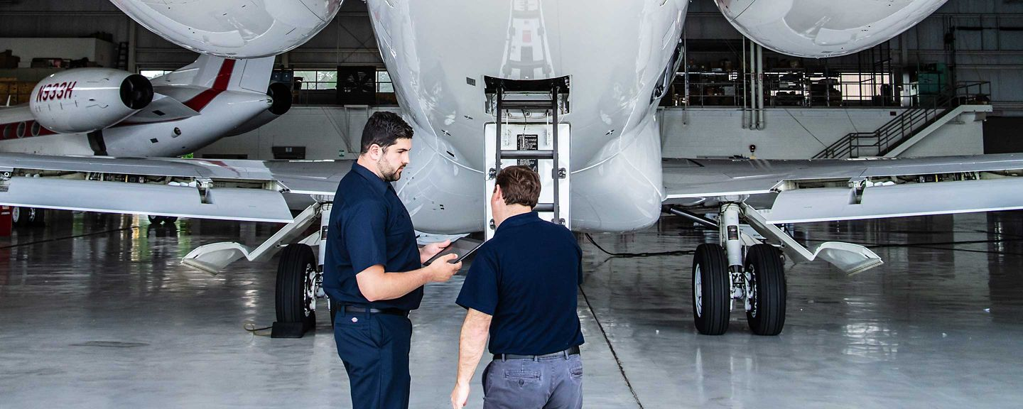 Director of Maintenance Inspecting Rear of G650