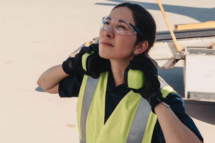 Woman checking airplane
