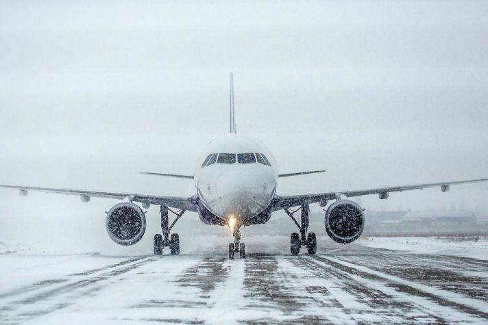 Plane winter runway