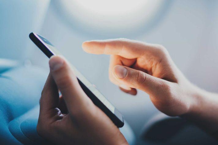 Aspire 400 man using phone