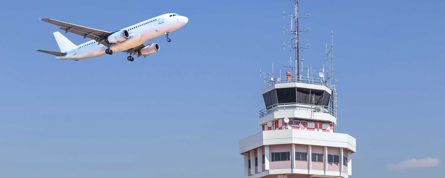 Plane over control tower