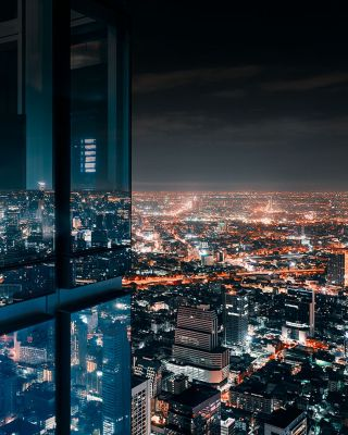 Lit up buildings at night in a city