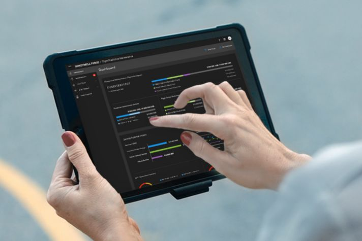 A person holding a tablet device