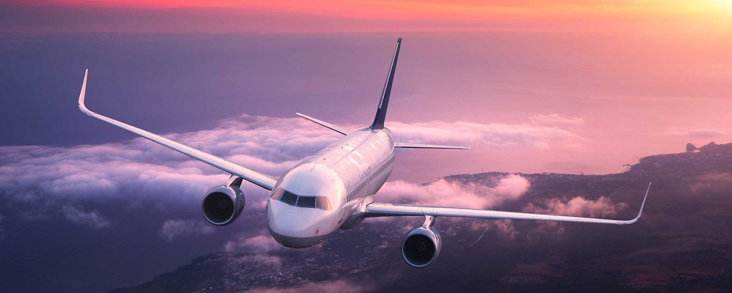 Airliner flying at sunset