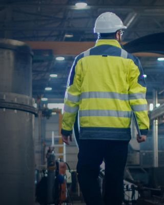 Worker in manufacturing plant