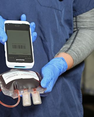 hands using a barcode scanner to scan a label