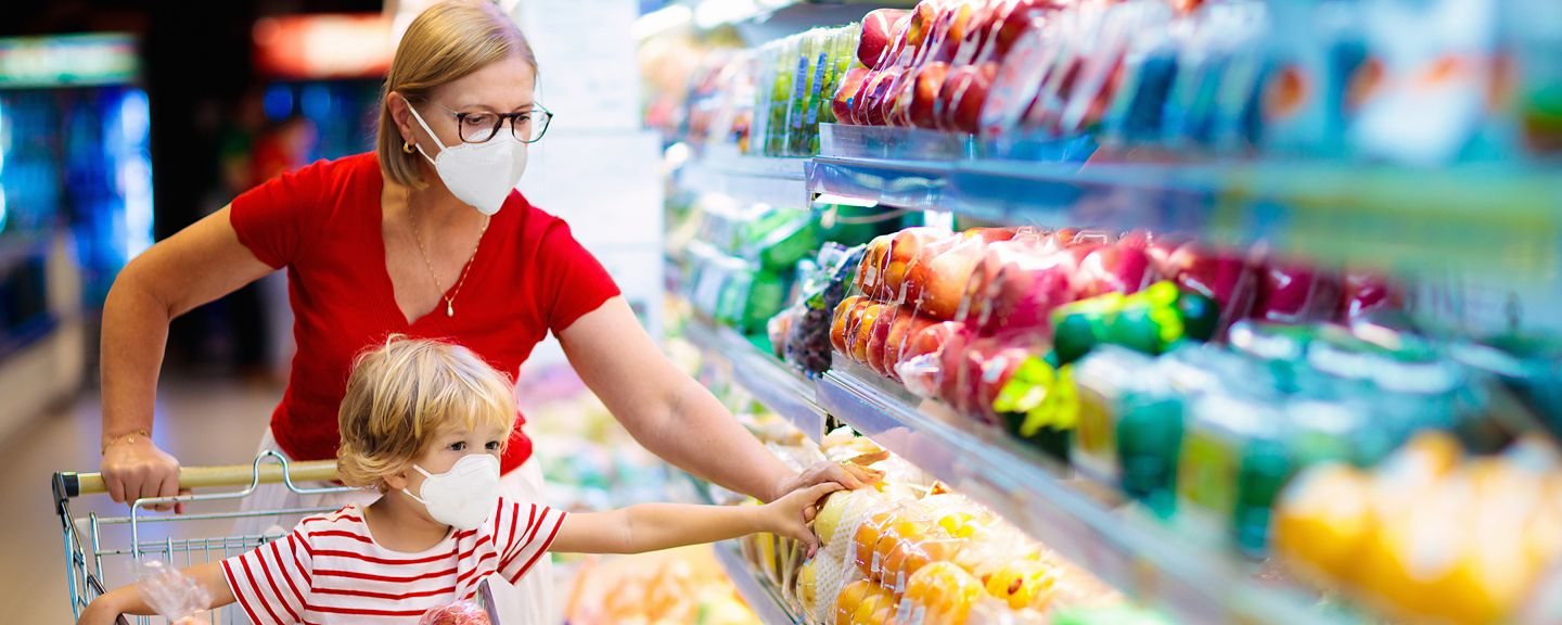 Woman grocery shopping  with her child