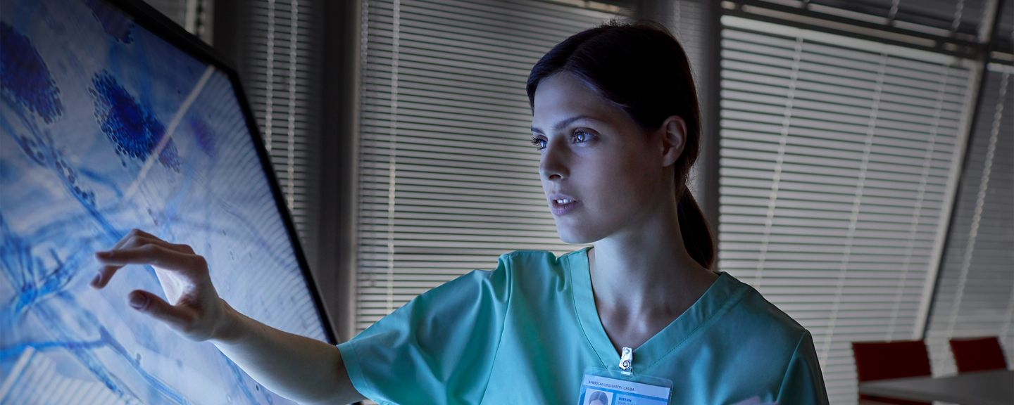 Healthcare professional using touchscreen