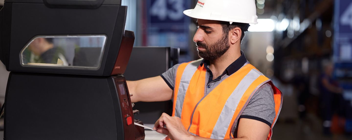 worker fixing a device
