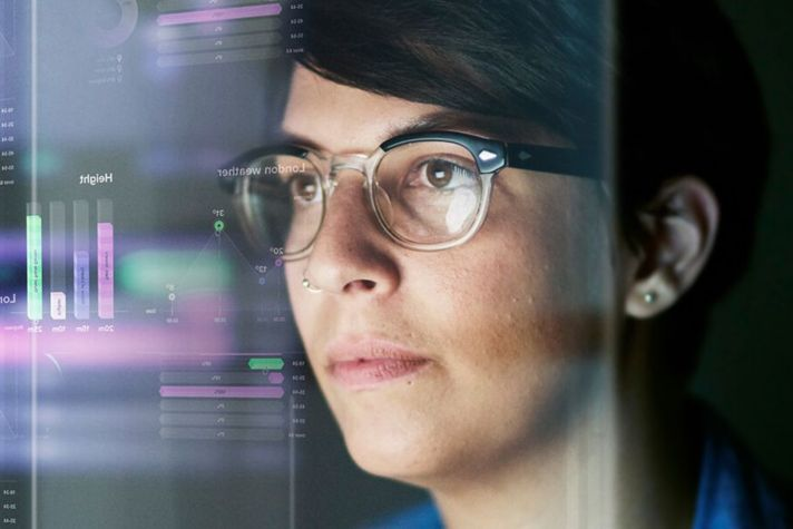 woman looking at insights from a server