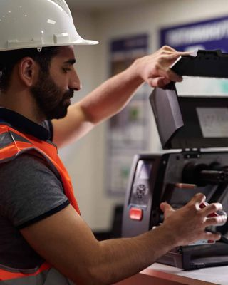 service worker wearing a helmet and fixing a device