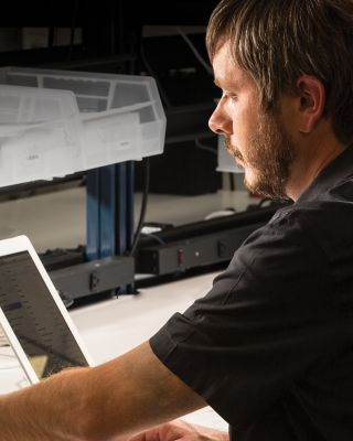 man monitoring device performance