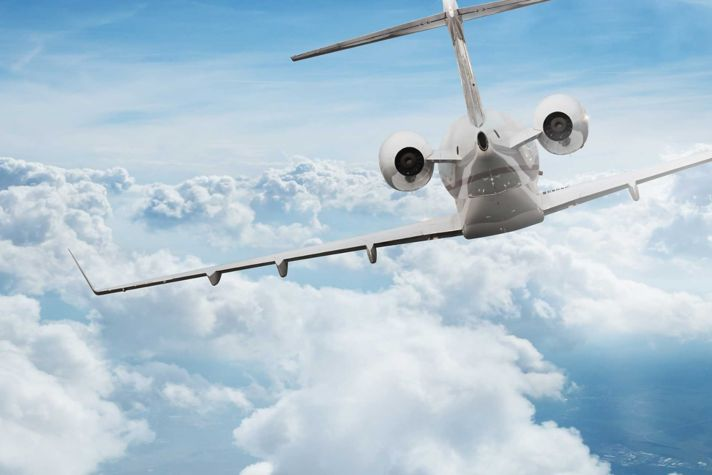 Business jet in clouds